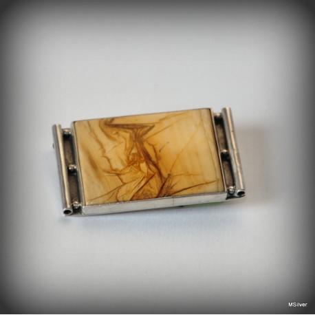 Srebrna broszka z brązowym kamieniem